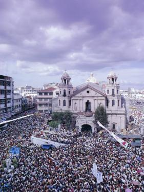 Crowds of Pilgrims and Devotees, Black Nazarene Festival, Downtown, Manila, Philippines by Alain Evrard