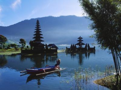Man in Boat Rowing and Hindu Temples at Lake Bratan, Pura Ulu Danau, Bali by Alain Evrard