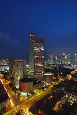 Raffles Hotel at Night and Skyline, Singapore, Asia by Alain Evrard