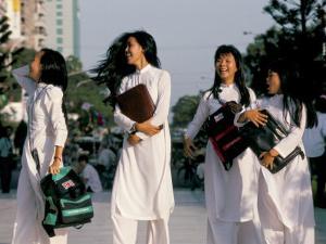 School Girls Facing Ho Chi Minh Statue, Ho Chi Minh City (Saigon), Vietnam, Indochina by Alain Evrard