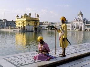 Sikhs in Front of the Sikhs' Golden Temple, Amritsar, Pubjab State, India by Alain Evrard
