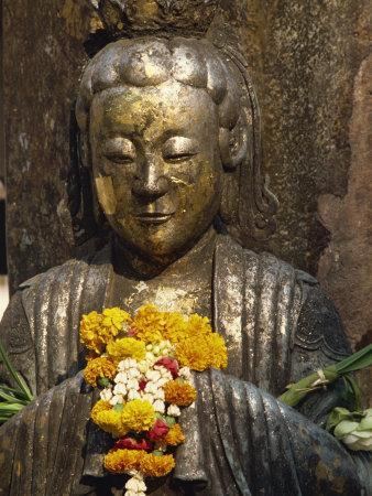 Statue with Offering of Marigold Flowers, Emerald Buddha Temple, Bangkok, Thailand, Southeast Asia