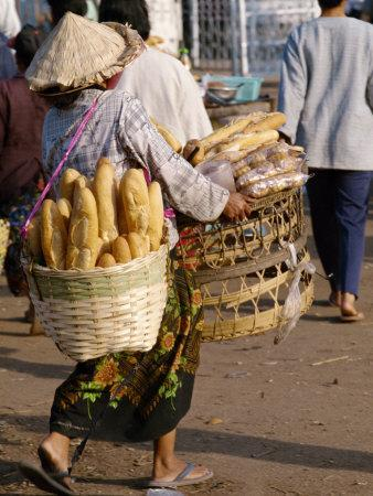 Woman Carrying Baskets of French Bread, Talaat Sao Market in Vientiane, Laos, Southeast Asia