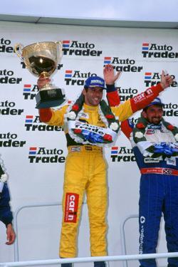 Alain Menu.British touring car driver celebrates victory