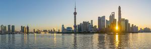 China, Shanghai, Pudong District, Skyline of the Financial District across Huangpu River at Sunrise by Alan Copson