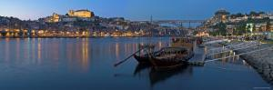 Ponte de Dom Luis I and Port Carrying Barcos, Porto, Portugal by Alan Copson
