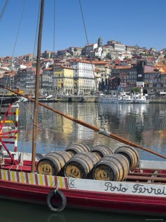 Port Carrying Barcos, Porto, Portugal by Alan Copson