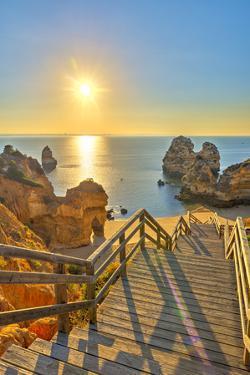 Portugal, Algarve, Lagos, Sunrise over Camilo Beach (Praia Do Camilo) by Alan Copson