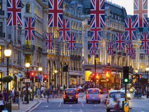 UK, England, London, Regent Street, Taxis and Union Jack Flags by Alan Copson