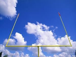 Football Goal Posts Against Sky by Alan Schein