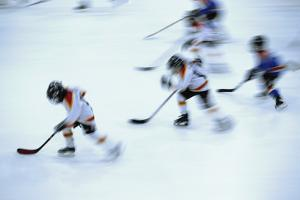 Young Hockey Players on Ice by Alan Schein Photography