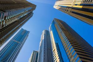 High Rise Buildings and Streets in Dubai, Uae by Alan64