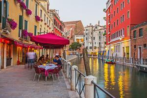 Narrow Canal among Old Colorful Brick Houses in Venice by Alan64