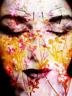 A Montage of a Portrait of a Womans Face with Flowers and Textures by Alaya Gadeh