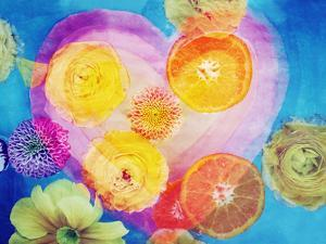 Composing of Blossoms and Slices of Orange Infront of Painted Heart by Alaya Gadeh