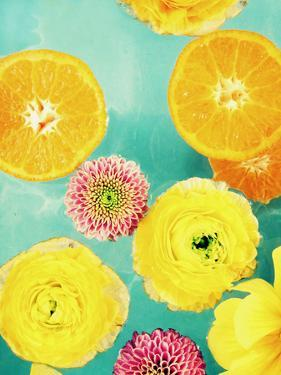 Composing of Blossoms and Slices of Orange on Blue Underground by Alaya Gadeh