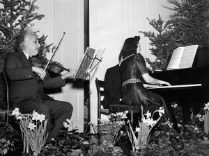 Albert Einstein Giving Violin Recital for American Friends Service Committee for Refugee Children