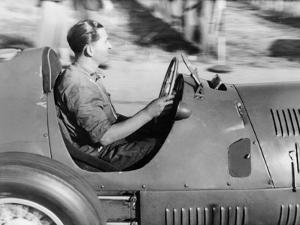 Alberto Ascari at the Wheel of a Racing Car