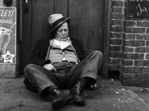 Alcoholic Vagrant Sleeping in a Doorway
