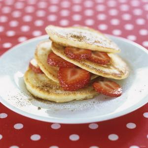 A Pile of Pancakes with Strawberries by Alena Hrbkova