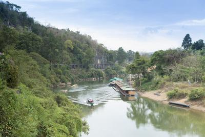 A Boat on the River Kwai with the Pow-Built Wampoo Viaduct Behind