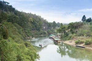 A Boat on the River Kwai with the Pow-Built Wampoo Viaduct Behind by Alex Robinson