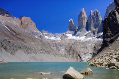 A glacial lake and the rock towers that give the Torres del Paine range its name, Torres del Paine