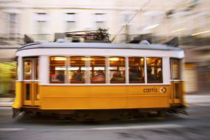 Europe, Portugal, Lisbon, a Speeding Tram (Streetcar) in the City Center by Alex Robinson