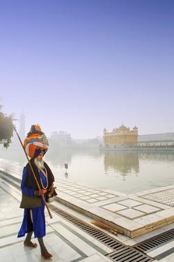 India, Punjab, Amritsar, a Sikh Pilgrim Carrying a Barcha Spear by Alex Robinson