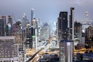 Skyline Showing the Skytrain and City Centre around Sukhumvit Road and Chit Lom, Bangkok, Thailand by Alex Robinson