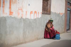 A Beggar Sits in the Street in Copacabana by Alex Saberi