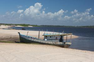 A Boat Sits on Rio Preguicas River Bank Near Lencois Maranhenses National Park by Alex Saberi