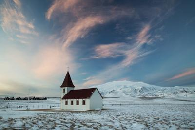 A church in the winter in western Iceland at sunset. by Alex Saberi