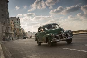 A classic Chevrolet car on the Malecon in Havana, Cuba. by Alex Saberi