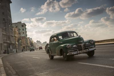 A classic Chevrolet car on the Malecon in Havana, Cuba. by Alex Saberi