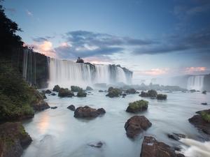 A Dramatic Sunset over Iguacu Waterfalls by Alex Saberi