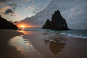 A Fisherman at Cacimba Do Padre with the Two Brothers Rock Formation at Sunset by Alex Saberi