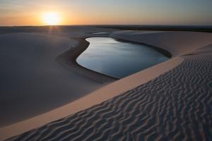 A Lagoon at Sunset in the Sand Dunes in Brazil's Lencois Maranhenses National Park by Alex Saberi