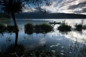 A Lone Fisherman on Lake Bratan at Dawn by Alex Saberi