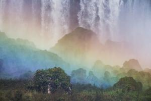 A Massive Rainbow Descends over Iguazu Falls by Alex Saberi