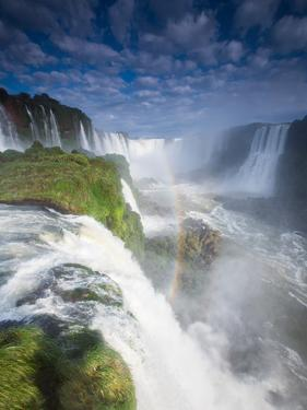 A Rainbow over Iguacu Falls in Brazil by Alex Saberi