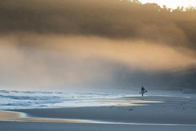 A Surfer on Juquehy Beach at Sunrise