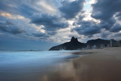 Dois Irmaos Peaks in the Distance on Ipanema Beach at Sunset