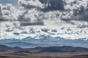 Dramatic Clouds Billow Above a Landscape with the Cordillera Real in the Distance by Alex Saberi