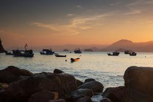 Fishermen's Boats Float Off the Coast of Praia Da Picinguaba, Ubatuba, Brazil by Alex Saberi