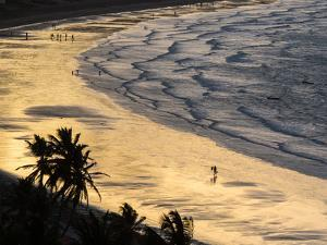 Icapui Beach, with People Fishing and Playing at Sunset by Alex Saberi