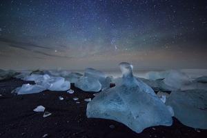 Iceberg on Black Sand Beach with Dramatic Sky by Alex Saberi