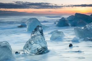 Icebergs on the Black Beach in Southern Iceland by Alex Saberi
