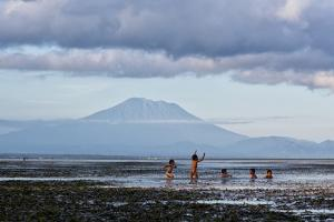 Kids Playing in the Water on the Coast of Bali by Alex Saberi