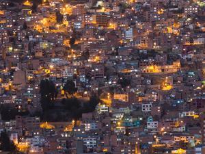 La Paz at Dusk with Patchwork Lit Up Buildings by Alex Saberi